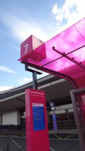The bright pink bus stop No 7